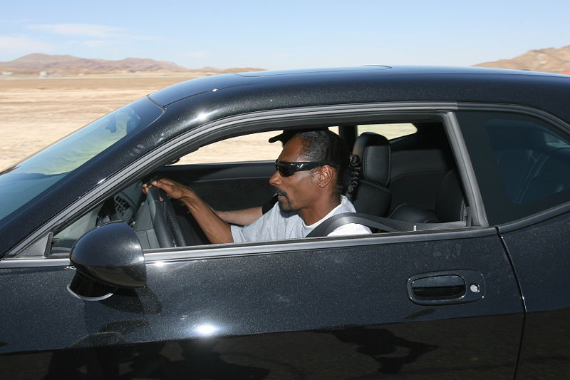 Snoop Dogg arrested for possession of 8 grams of weed at Kjevic Airport in Kristiansand. Here, he enjoys the ride in a 2008 Dodge Challenger (By dodge challenger1 via Wikimedia Commons)