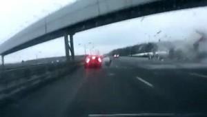 Driver breaks car before being hit by plane's wheel on Moscow freeway