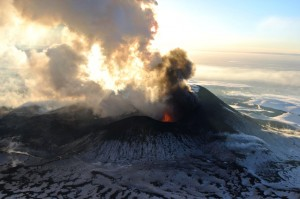 This flyover photo was snapped on Jan. 6, 2013 and shows Tolbachik volcano spewing ash and smoke in the atmosphere of Kamchakta Peninsula