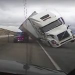 VIDEO: Strong crosswind blowing big truck on top of police car in Wyoming